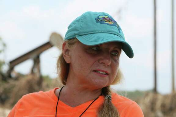 Joy Rizzi has questioned the decision to open the Lake Conroe flood gates.