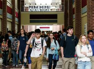 Students walk the hallway between classes during the first day for students returning to school at The Woodlands College Park High School on Tuesday, Sept. 5, 2017, in The Woodlands. Students in the Conroe Independent School District returned to classes for the first time since Hurricane Harvey hit the area.