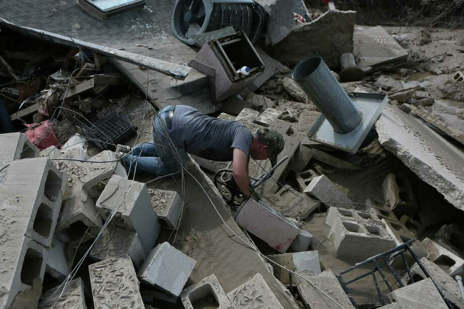David Kruciak of Kingwood digs through the debris at the Riverview at Forest Cove complex on, Sunday, Sept. 3, at Aqua Vista Drive in Kingwood, TX, following flooding of the San Jacinto River caused by Tropical Storm Harvey. ( Scott Kingsley / Houston Chronicle ) Photo: Scott Kingsley / Houston Chronicle