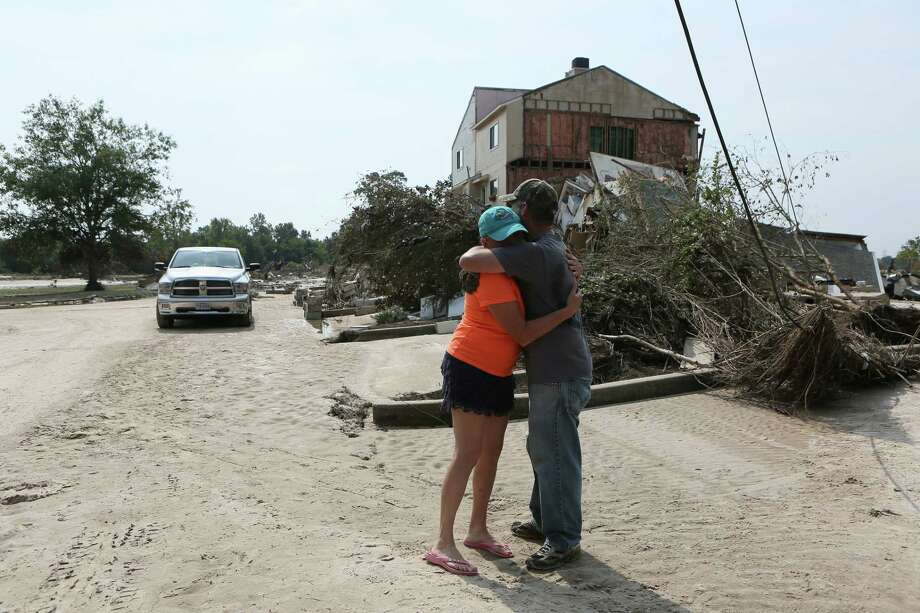Joy Rizzi hugs her friend David Kruciak of Kingwood who came to help her at the Riverview at Forest Cove complex, Sunday, Sept., 3 on Aqua Vista Drive in Kingwood, TX, following flooding of the San Jacinto River caused by Tropical Storm Harvey. ( Scott Kingsley / Houston Chronicle ) Photo: Scott Kingsley / Houston Chronicle