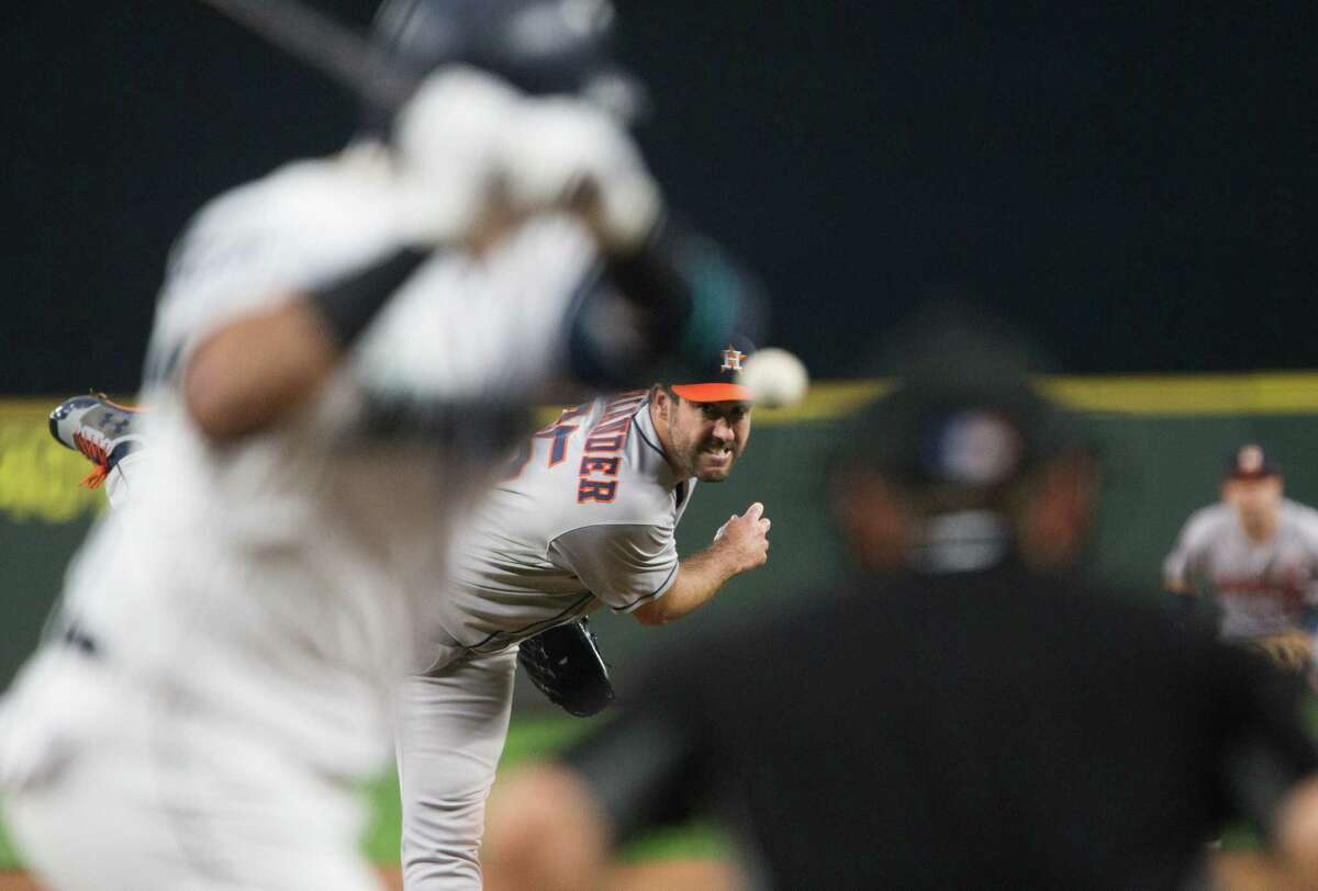 SEATTLE, WA - SEPTEMBER 05: Justin Verlander #35 of the Houston Astros pitches against Nelson Cruz #23 of the Seattle Mariners during his debut with the Astros at Safeco Field on September 5, 2017 in Seattle, Washington.