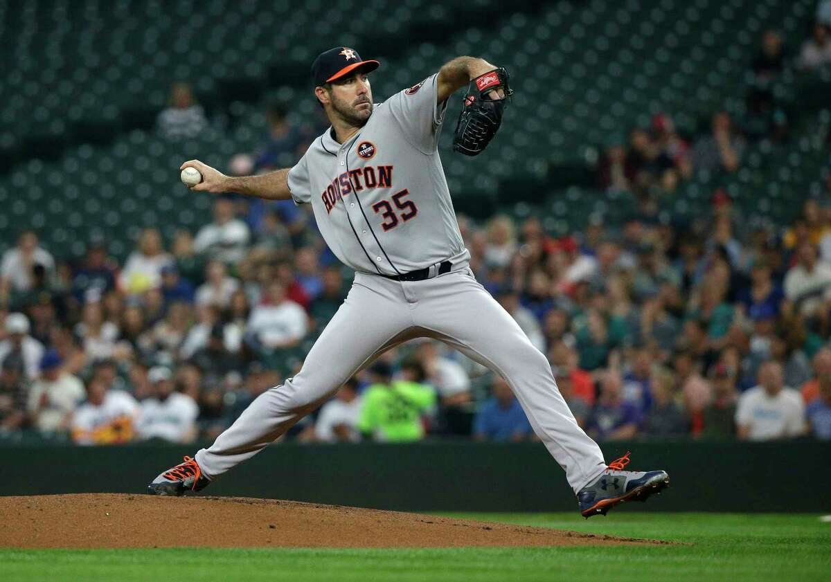 Houston Astros starting pitcher Justin Verlander throws against the Seattle Mariners in the first inning of a baseball game, Tuesday, Sept. 5, 2017, in Seattle. (AP Photo/Ted S. Warren)