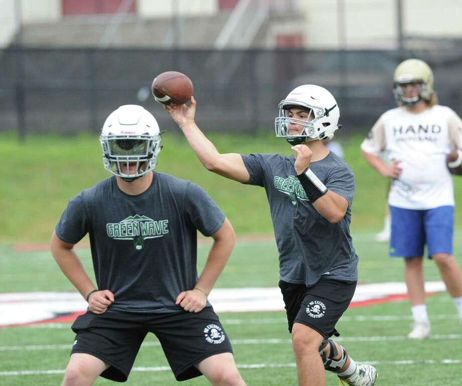 New Milford High quarterback Tyler Sullivan, right, during the Grip It & Rip It football tournament in July at New Canaan High School. Photo: Bob Luckey Jr. / Hearst Connecticut Media / Greenwich Time