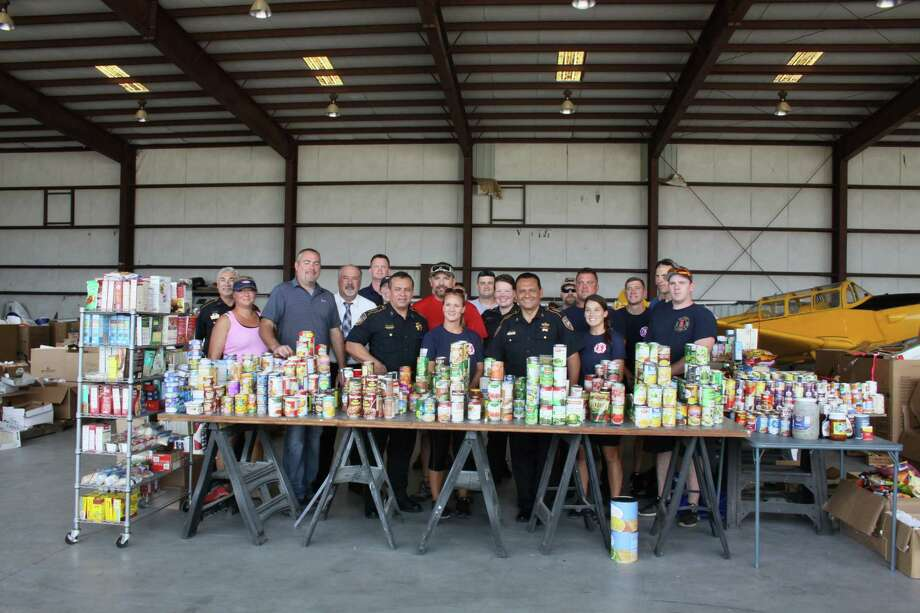 Harris County Sheriff Ed Gonzalez, third from right, poses with volunteers delivering, sorting and distributing donations from other states forHouston-area first responders who have been affected by Harvey. Photo: Mayra Cruz