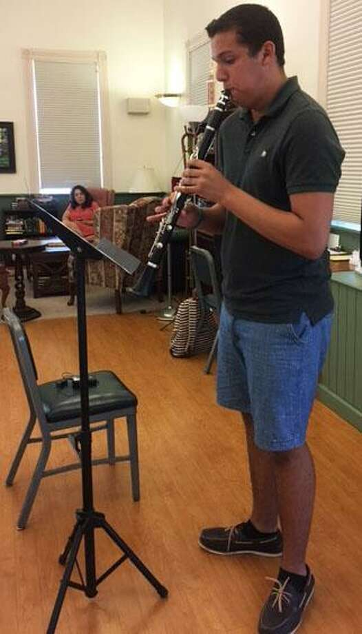 A group of New Milford High Schools students recently visited the Sherman Senior Center to provide an afternoon of entertainment. Students shared their musical talent during the program, followed by a reception. Photo: Contributed Photo / Contributed Photo / The News-Times Contributed