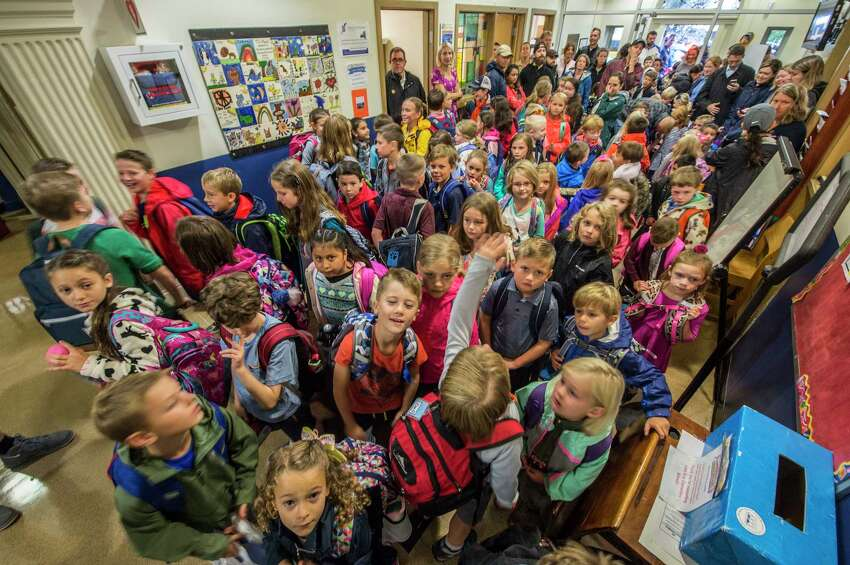 Students queue up for class in the foyer of the building on the first day of school at the Lake Avenue Elementary School on Wednesday, Sept. 6, 2017, in Saratoga Springs, N.Y. (Skip Dickstein/Times Union)