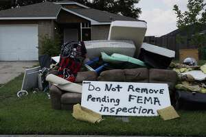 "HOUSTON, TX - SEPTEMBER 02: A sign reads, "" Do Not Remove Pending FEMA inspection', is seen with water logged items that were placed on the curb in front of a home as people start to rebuild their homes that were inundated with water after torrential rains caused widespread flooding during Hurricane and Tropical Storm Harvey on September 2, 2017 in Houston, Texas. Harvey, which made landfall north of Corpus Christi on August 25, dumped around 50 inches of rain in and around areas of Houston and Southeast Texas.  (Photo by Joe Raedle/Getty Images)"
