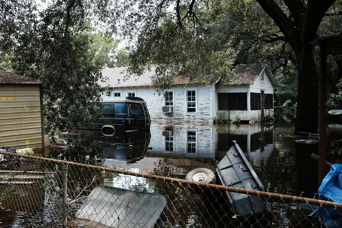 HARTBURG, TX - SEPTEMBER 05: Flooded homes stand in downtown Hartburg as Texas slowly moves toward recovery from the devastation of Hurricane Harvey on September 5, 2017 in Hartburg, Texas. Almost a week after Hurricane Harvey ravaged parts of the state, some neighborhoods still remained flooded and without electricity. While downtown Houston is returning to business, thousands continue to live in shelters, hotels and other accommodations as they contemplate their future. (Photo by Spencer Platt/Getty Images)