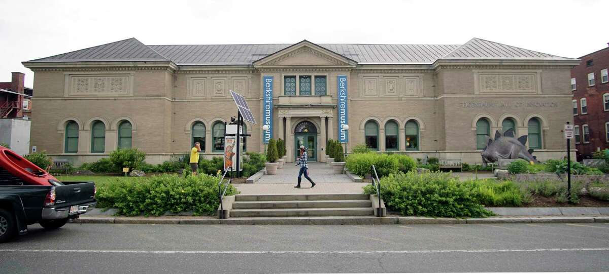In this Wednesday, July 12, 2017 photo, a pedestrian walks past the Berkshire Museum in Pittsfield, Mass. The museum has come under intense national and local pressure after announcing earlier in the month that it is selling 40 works of art, including two by Normal Rockwell, the illustrator who called the region home for the last 30-plus years of his life.