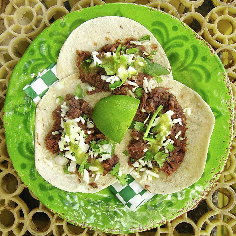 Taco of the Week: Barbacoa tacos with cabbage, cilantro and salsa verde on hot corn tortillas from the Tacos Lira truck. Photo: Mike Sutter /San Antonio Express-News