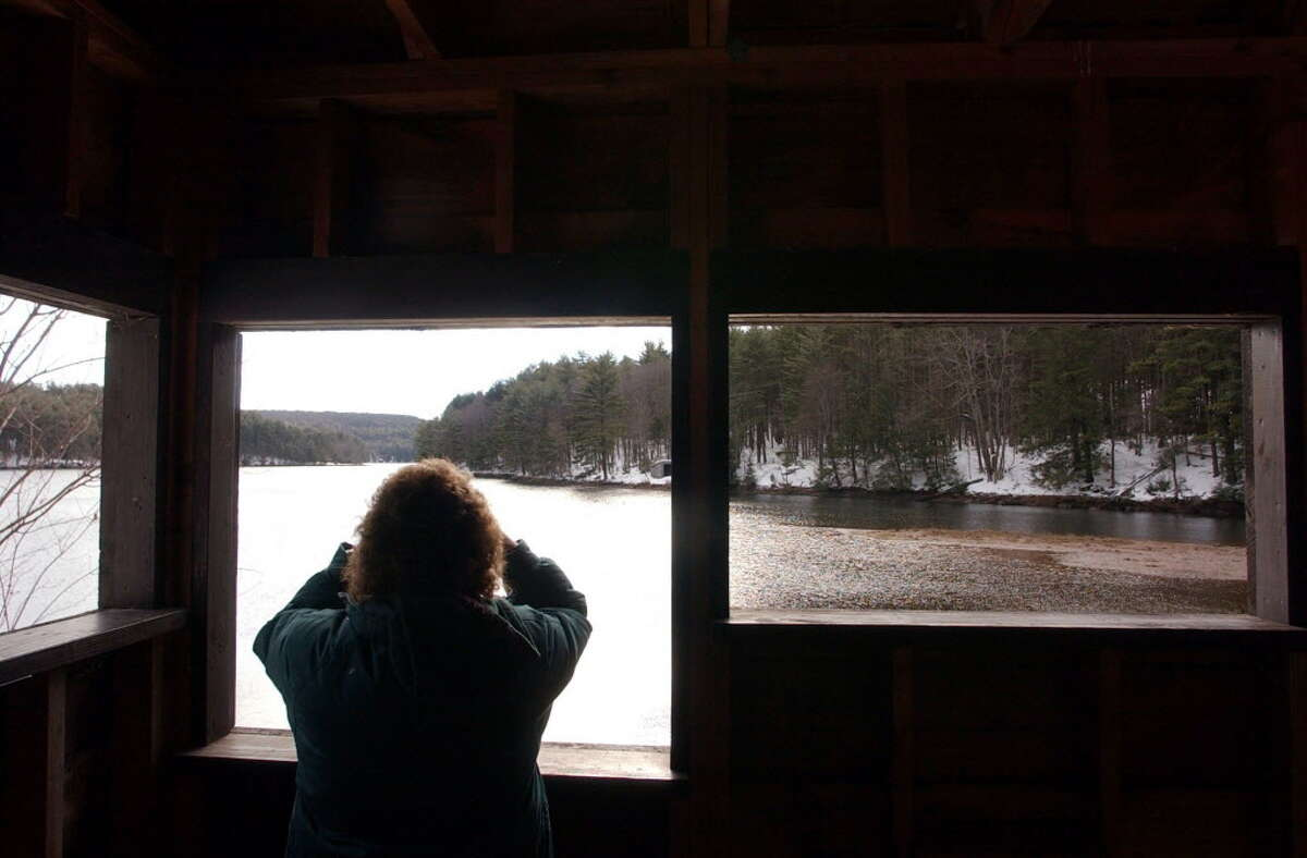 FORESTBURGH, NEW YORK - Lori McKean, director of The Eagle Institute, looks for Eagles feeding in the Mongaup Falls Reservoir near Forestburgh, New York, not far from the Delaware River. The Eagle Institute helps facilitate tourists interested in watching the birds by placing guides at popular viewing sites. The area surrounding the Delaware River near Lackawaxen, Pennsylvania, has become a tourist attraction for visitors who come to see Canadian Eagles which winter along the river on the New York and Pennsylvania border. Photo taken Thursday, January 9, 2003. (Douglas Benedict/THE MORNING CALL)