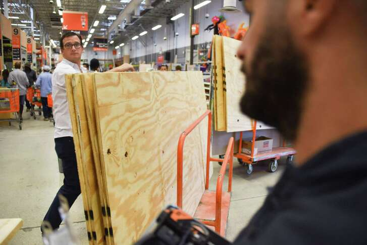 People shop for plywood at Home Depot in preparations for Hurricane Irma in North Miami.