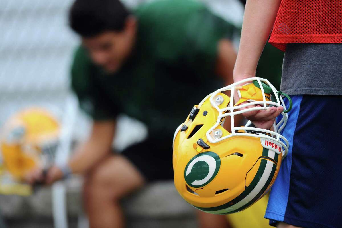 The Trinity Catholic High School varsity football team practices on Gaglio Field in Stamford, Conn. on Thursday, August 31, 2017. The team is donating a portion of their equipment fundraiser to help Hurricane Harvey relief in Texas as well as facilitation a donation box for food and water.