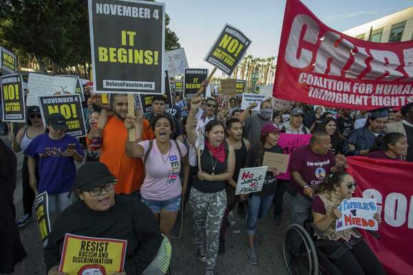 Immigrants and supporters rally and march in opposition to the President Trump order to end DACA, on Tuesday in Los Angeles. The Obama-era Deferred Action for Childhood Arrivals program protects young immigrants who grew up in the U.S. after arriving with their undocumented parents from deportation to a foreign country. President Trump is phasing it out.