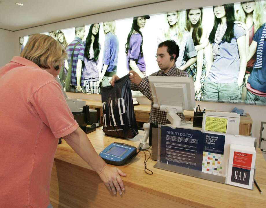 A Gap clerk rings up a purchase in Palo Alto, Calif. The retail giant announced on Sept. 6, 2017, plans to close some 200 Gap and Banana Republic stores nationally, while adding 270 Old Navy and Athleta locations. (AP Photo/Paul Sakuma, file) Photo: Paul Sakuma / AP / AP