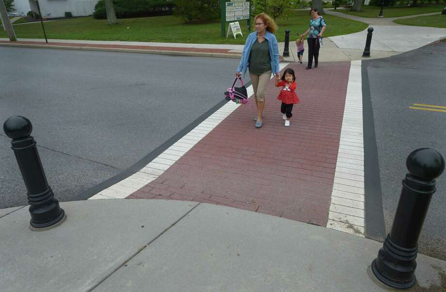 Pedestrians use the crosswalks on River Road Wednesday, Sept. 6 in Wilton. Photo: Erik Trautmann / Hearst Connecticut Media / Norwalk Hour