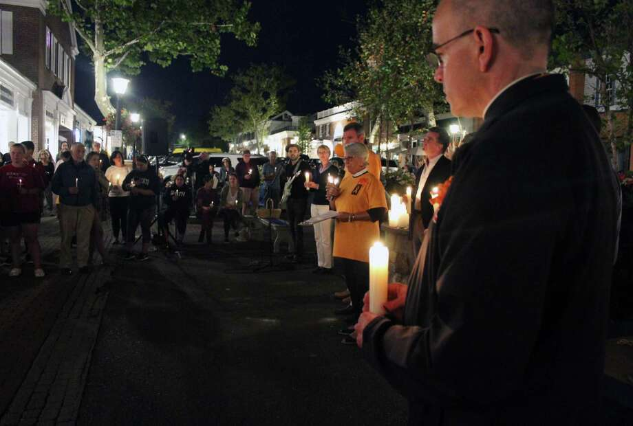 Clockwise from left: New Canaan's first Overdose Awareness Day Vigil on Aug. 31 ended in candlelight and song. Richard and Karen King, members of the recovery community. New Canaan resident Nicole Rhind views the Wall of Remembrance. Photo: Erin Kayata / Hearst Connecticut Media / New Canaan News