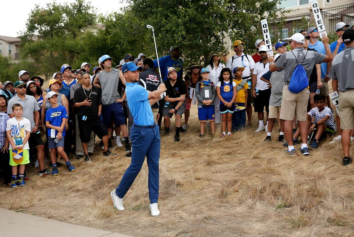 Golden State Warriors star Stephen Curry hits out of trouble on the 13th hole during the first round of the Ellie Mae Classic golf tournament at TPC Stonebrae in Hayward, Ca., on Thurs. August 3, 2017.
