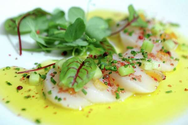 Diver scallop crudo, pickled cucumbers, candied orange zest, pink peppercorns, Hawaiian sea salt, olio verde at the new Patio at 15 Church restaurant on Monday, June 8, 2015 in Saratoga Springs, N.Y. (Lori Van Buren / Times Union) ORG XMIT: MER2015060913501827