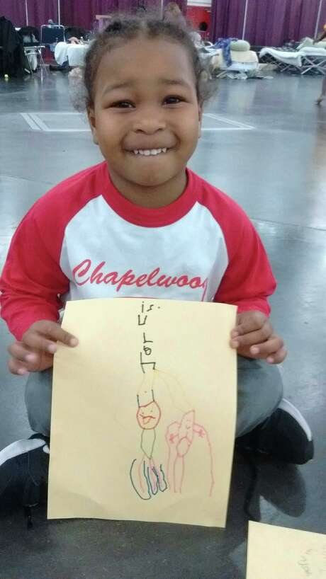 Five-year-old Jarvis worked with WITS writer Dorothy Joan Price at the GRB as Harvey evacuees gathered to shelter. Photo: Robin Reagler / Facebook