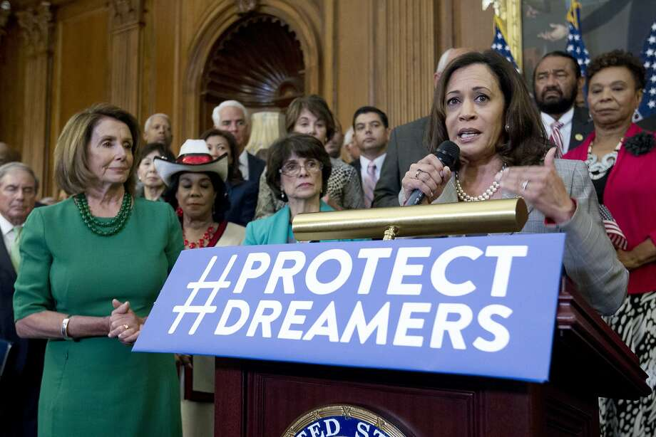Sen. Kamala Harris, accompanied by House Minority Leader Nancy Pelosi left, and others members of the House and Senate Democrats, speaks during a news conference on Capitol Hill in Washington, Wednesday, Sept. 6, 2017. House and Senate Democrats gather to call for Congressional Republicans to stand up to President Trump's decision to terminate the Deferred Action for Childhood Arrivals (DACA) initiative by bringing the DREAM Act for a vote on the House and Senate Floor. ( AP Photo/Jose Luis Magana) Photo: Jose Luis Magana, Associated Press