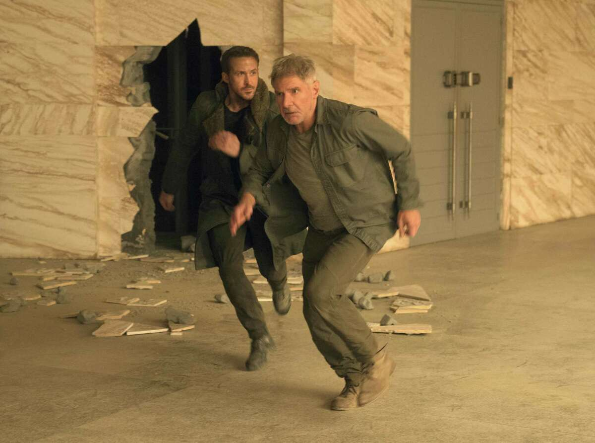 """Ryan Gosling, left, and Harrison Ford star in """"Blade Runner 2049,"""" a sci-fi sequel that actually may be worth your time."""