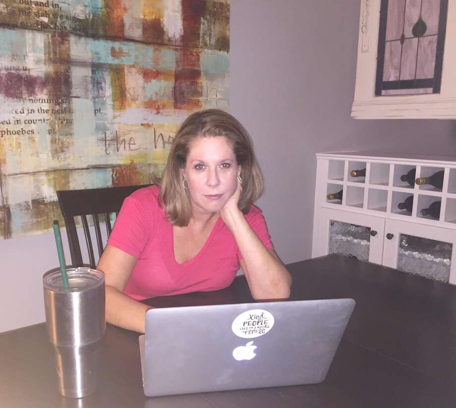 Holly Hartman, at the dining room table where she helped the Cajun Navy rescue Houstonians after Tropical Storm Harvey. Photo: Dale Dye, Courtesy Holly Hartman