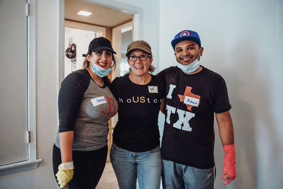 Wedding planner Kat Creech, center, with Sarah Samad and Mohsin Karedia. Recovery Houston is a grassroots volunteer organization that was started after Hurricane Harvey hit the Houston area. Photo: Ana Khan