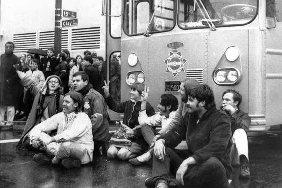 Anti-war demonstrators sit in the street blocking access to  the Oakland  Induction Center at Clay and 15th streets in Oakland , December 18, 1967 Vietnam War protesters United Press International