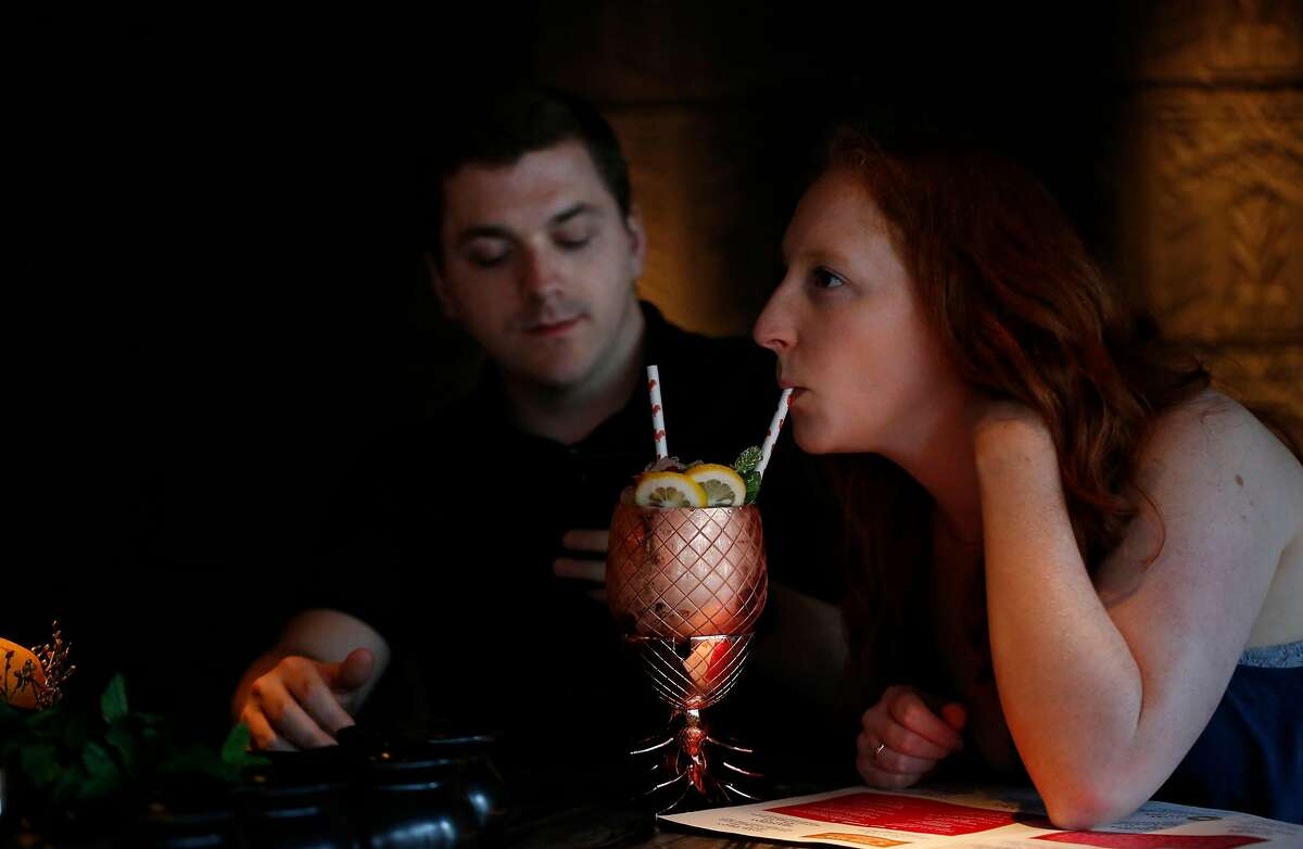 Hunter McMillen and Sydney Schmit enjoy their Long Islay Iced Tea at Cold Drinks bar at China Live Sept. 5, 2017 in San Francisco, Calif.