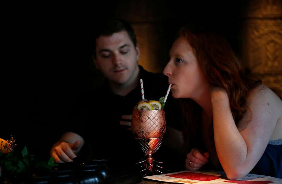Hunter McMillen and Sydney Schmit share a Long Islay Iced Tea at Cold Drinks bar at China Live in S.F. Photo: Leah Millis, The Chronicle