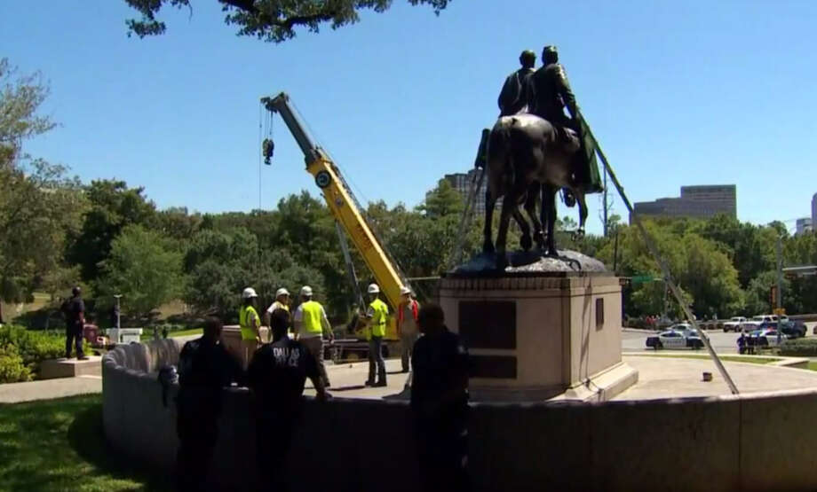 While cranes and work crews prepared to remove a statue of Robert E. Lee from a public park on Dallas Wednesday, their work was halted thanks to an injunction filed by one man. Photo: WFAA/Facebook
