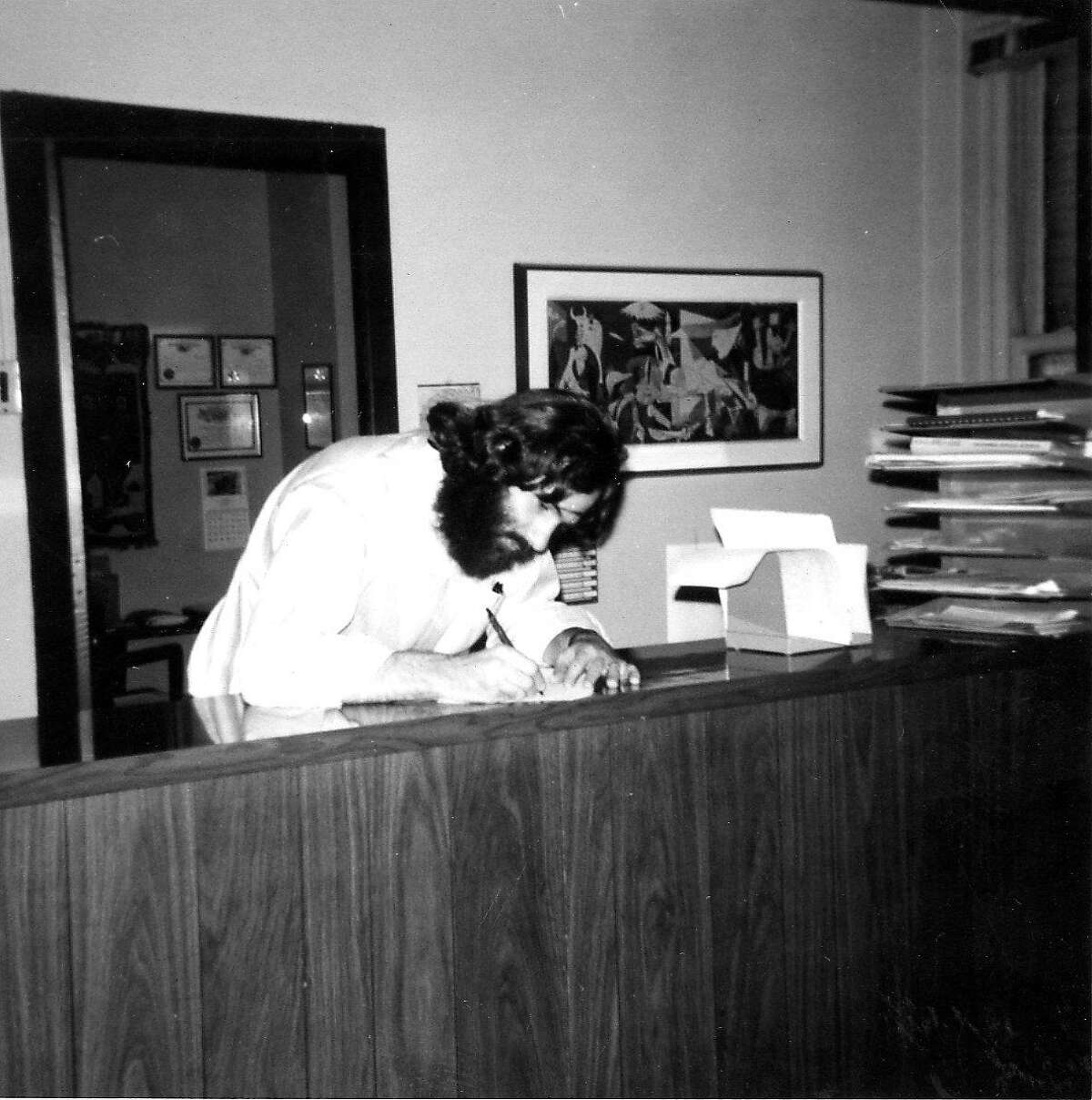 Jerry Garchik, working as a law clerk in the Boston office of the lawyers defending him, 1970 Handout