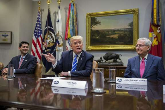 U.S. President Donald Trump speaks as Senate Majority Leader Mitch McConnell, a Republican from Kentucky, right, and U.S. House Speaker Paul Ryan, a Republican from Wisconsin, left, listen during a meeting with members of Congress and Trump's administration regarding tax reform in the Roosevelt Room of the White House in Washington, D.C., U.S., on Tuesday, Sept. 5, 2017. Congress, back from its August vacation, has less than a month to avert a default on the nations debt and avoid a government shutdown. The pressure of dealing with Harveys destruction, possible more damage from Hurricane Irma and the North Korea crisis could make a fiscal fight less likely. Photographer: Shawn Thew/Pool via Bloomberg