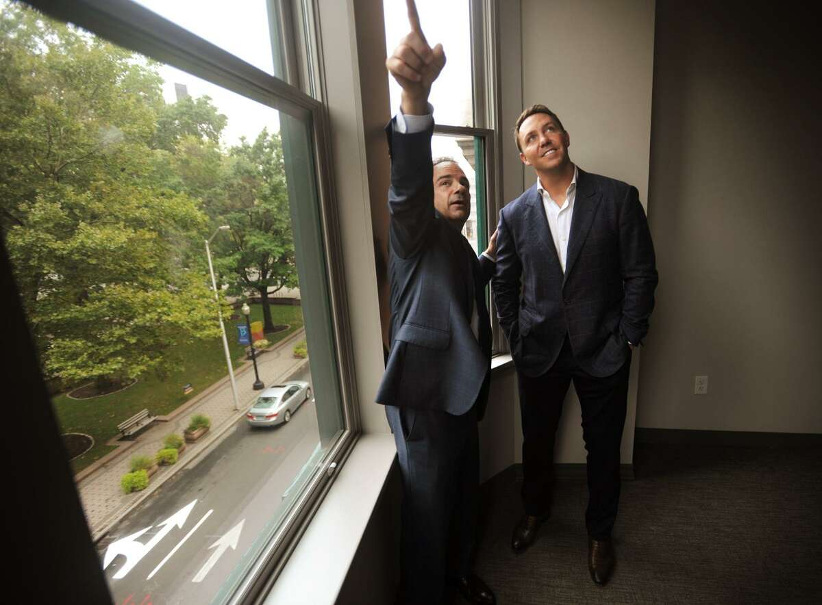 Bridgeport Mayor Joe Ganim, left, asks about an apartment with a bay window during a tour of the new McLevy Square Apartments with Brandon Hall, principal of project developer Forestone Capital on Wednesday, September 6, 2017. The tour followed a ribbon cutting ceremony for the thirty-two apartments at the historic 177-189 State Street building.