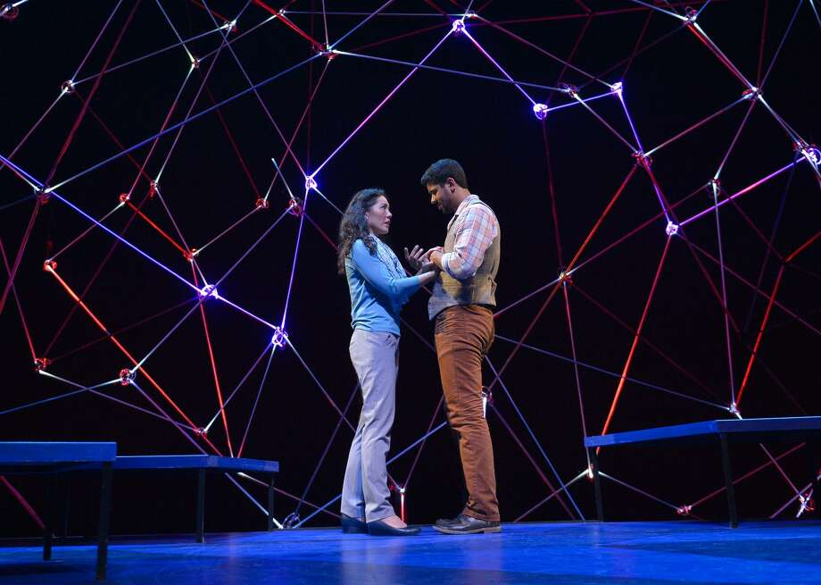 """Cosmologist Marianne (Carie Kawa) and beekeeper Roland (Robert Gilbert) explore life's """"what-ifs"""" in """"Constellations."""""""