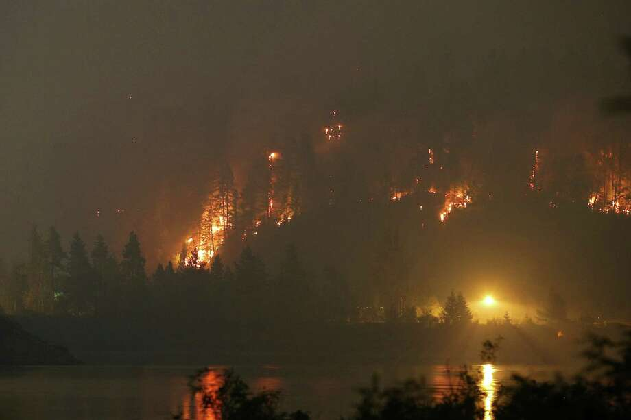 The Eagle Creek Fire lights up a hillside on the Oregon side of the Columbia River Gorge near Cascade Locks and the Bridge of the Gods, Tuesday night, Sept. 5, 2017. Genna Martin, seattlepi.com) Photo: GENNA MARTIN, SEATTLEPI.COM / SEATTLEPI.COM