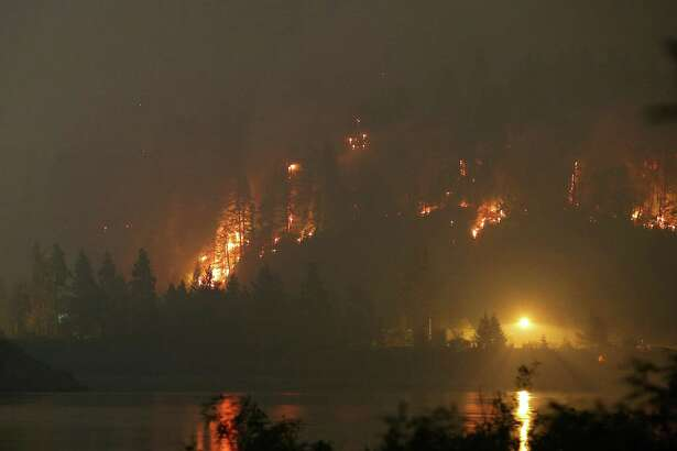 The Eagle Creek Fire lights up a hillside on the Oregon side of the Columbia River Gorge near Cascade Locks and the Bridge of the Gods, Tuesday night, Sept. 5, 2017. Genna Martin, seattlepi.com)
