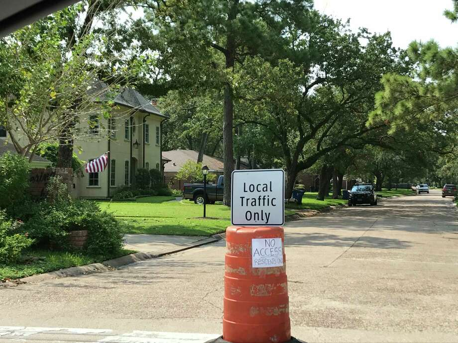 """With traffic on major highways throughout the greater Houston area in the days following Hurricane Harvey, local neighborhoods are being sought out as possible thoroughfares. However, this scene along Memorial Drive is becoming more commonplace.Many residential streets have """"no trespassing"""" signs at the entrance off Memorial. Photo: Jaimy Jones / Houston Chronicle"""