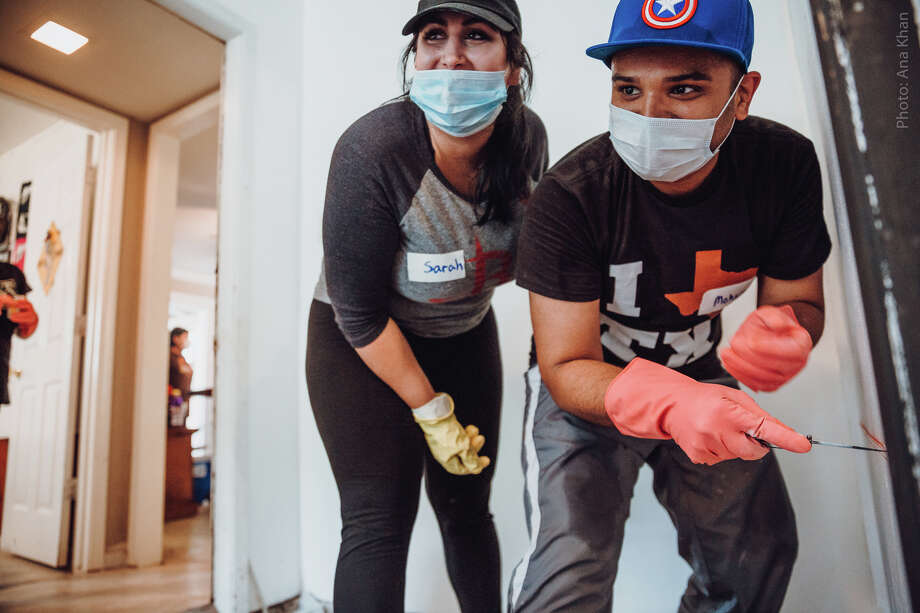 Sarah Samad and Mohsin Karedia help remove drywall in a home that was flooded during Hurricane Harvey. The couple postponed their Labor Day weekend wedding to volunteer. Photo: Ama By Aisha