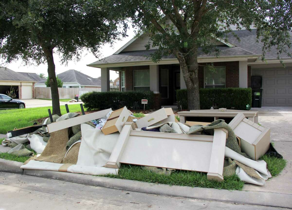 Alice Riley's street in Canyon Village at Cypress Springs is lined with items that were once in people's home sthat were ruined by the floodwaters of Harvey.