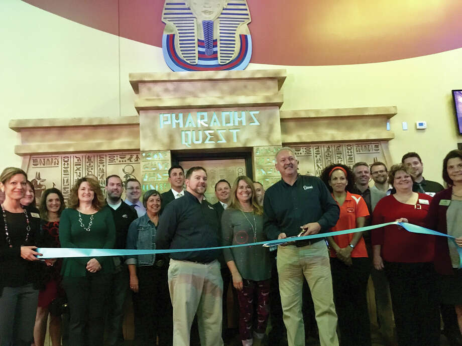 Edison Entertainment Marketing Manager (left) Tom Rezabeck and CEO and President Matt McSparin cut the ribbon to their new laser tag facility. Photo: Steve Horrell