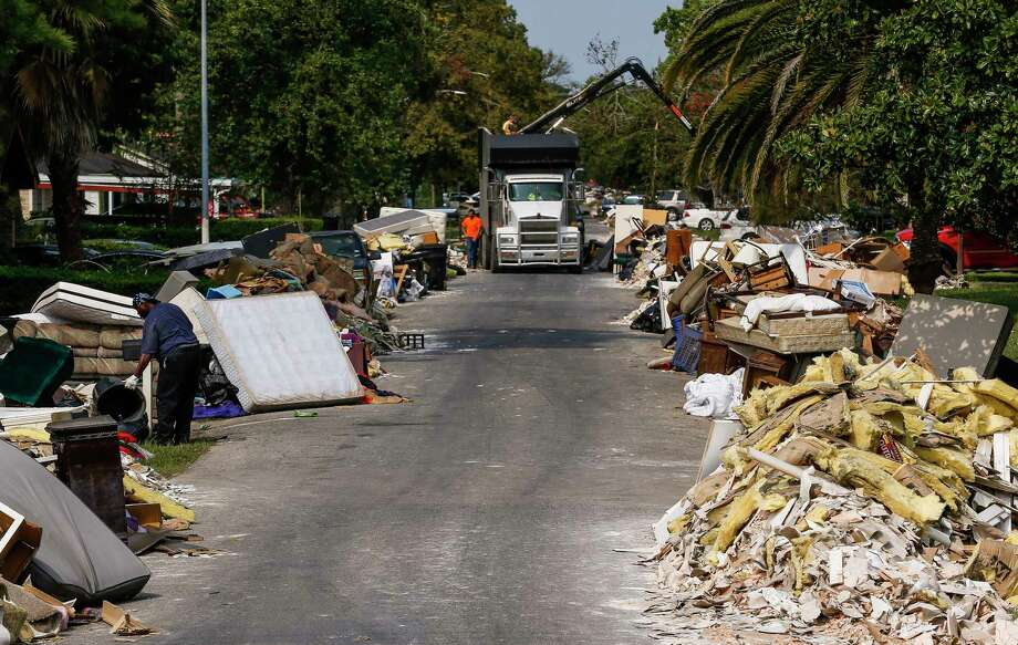 Debris removal began on Homewood Lane near west Houston's Memorial City on Wednesday, Sept. 6, 2017. Photo: Michael Ciaglo, Houston Chronicle / Michael Ciaglo