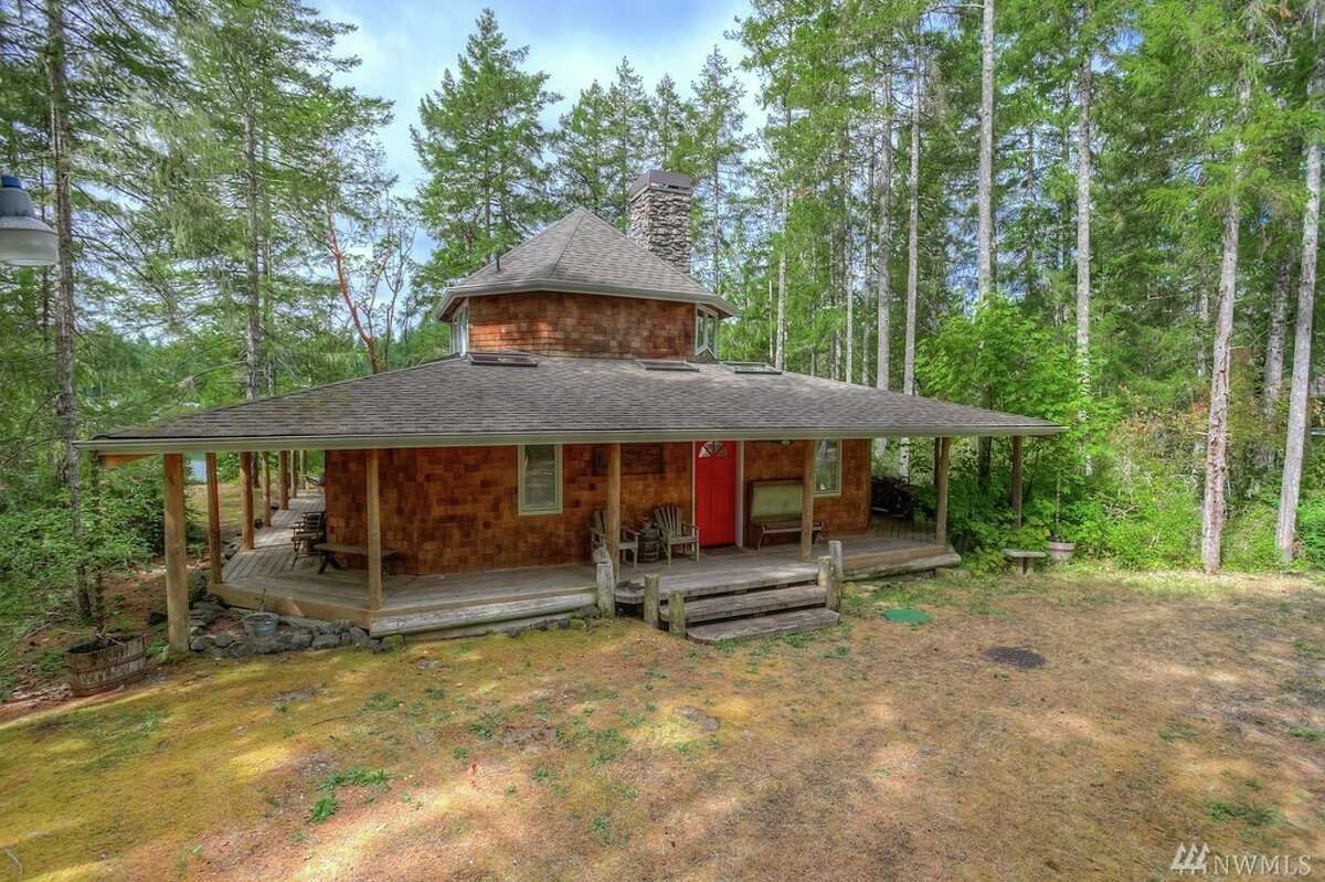 This cabin at 3651 E Harstine Island Rd. N. is listed for $400,000. It is on Harstine Island in South Puget Sound.