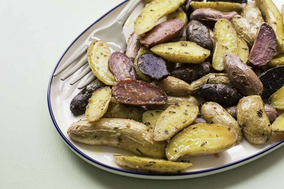 Herb-roasted Fingerling Potatoes Photo: Sarah E. Crowder /Associated Press / Stratford Booster Club