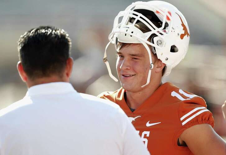 Sam Ehlinger talks with offensive coordinator Tim Beck of the Texas Longhorns before the game against the Maryland Terrapins on Sept. 2, 2017 in Austin.
