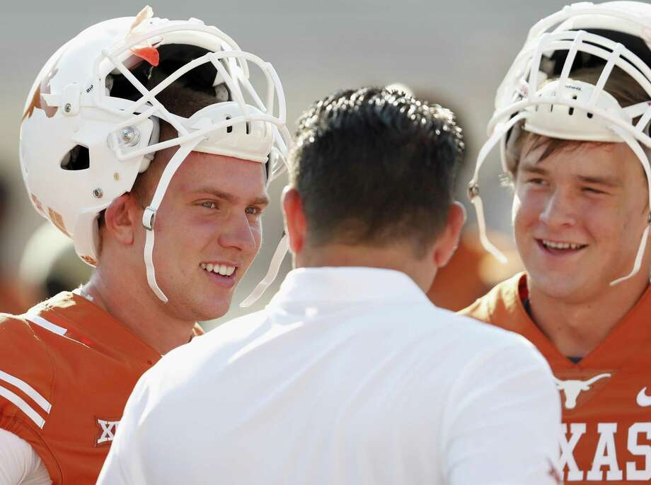 Shane Buechele (left) and Sam Ehlinger (right) talk with offensive coordinator Tim Beck of the Texas Longhorns before the game against the Maryland Terrapins at Royal-Memorial Stadium on Sept. 2, 2017 in Austin. Photo: Tim Warner /Getty Images / 2017 Tim Warner