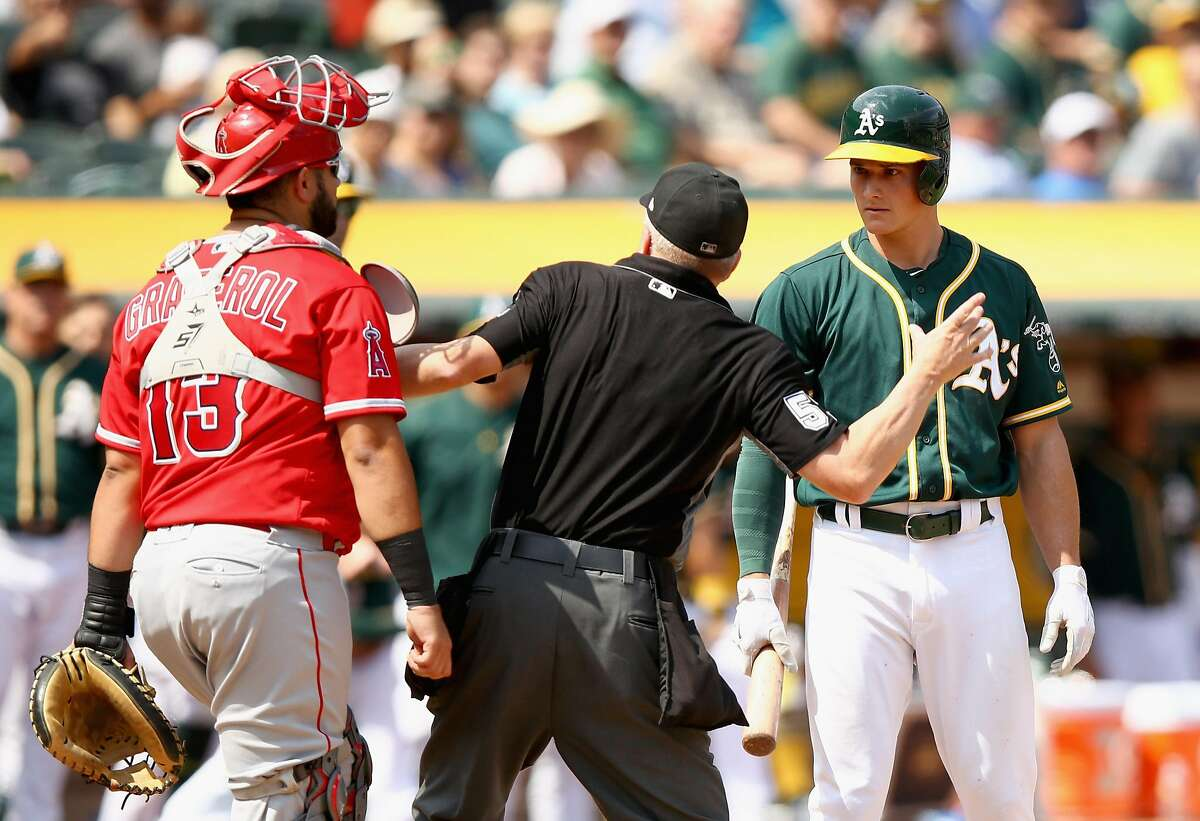 OAKLAND, CA - SEPTEMBER 06: Matt Chapman #26 of the Oakland Athletics is ejected from the game by home plate umpire Mike Everitt after having words with Juan Graterol #13 of the Los Angeles Angels in the fourth inning at Oakland Alameda Coliseum on September 6, 2017 in Oakland, California. (Photo by Ezra Shaw/Getty Images)