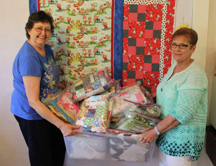 Linda Deeter (left) and Amanda Marshall (right) of the Coldspring chapter of Quilts for Kids display a container full of quilts intended for children impacted by Hurricane Harvey. Photo: Jacob McAdams