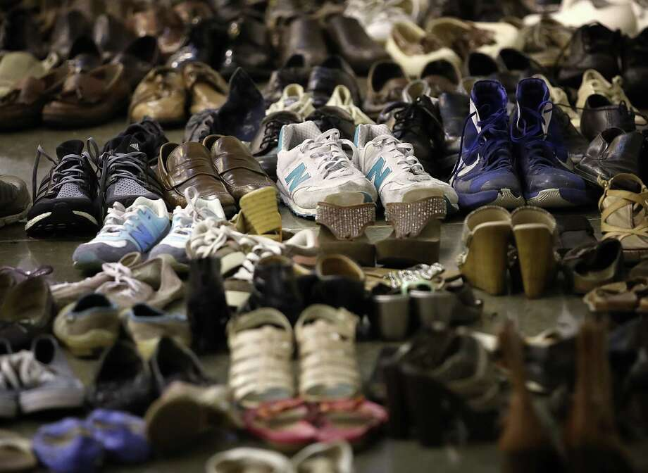 HOUSTON, TX - AUGUST 31:  Donated shoes for evacuees forced from their homes due to flooding are shown at the NRG Center August 31, 2017 in Houston, Texas. Thousands of Houston area residents are living in temporary shelters as the city of Houston is still experiencing severe flooding in some areas due to the accumulation of historic levels of rainfall, though floodwaters are beginning to recede in many parts of the city.  (Photo by Win McNamee/Getty Images) Photo: Win McNamee, Staff / 2017 Getty Images